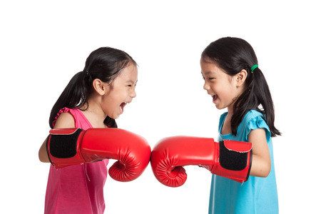 Happy Asian twins girls  with boxing gloves  isolated on white background