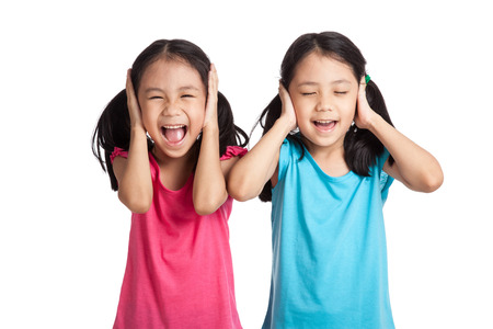 Asian twins girls cover their ears  isolated on white background
