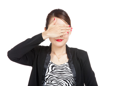 well dressed girl: Young Asian business woman close her eyes with hand  isolated on white background Stock Photo
