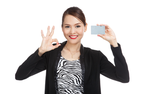 happy asian people: Young Asian business woman show OK with a blank card  isolated on white background