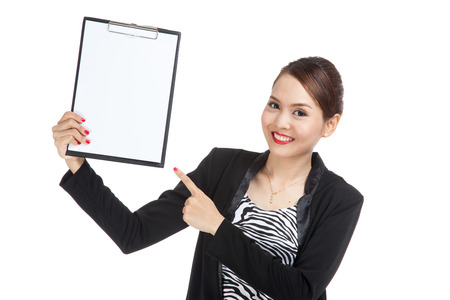 well dressed girl: Young Asian business woman point to blank clipboard  isolated on white background