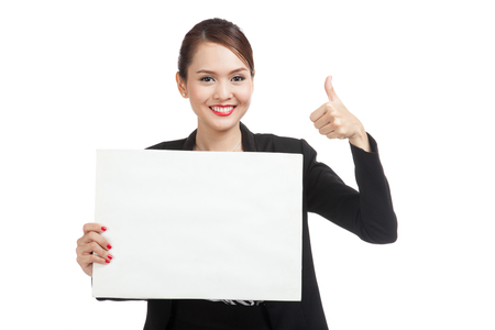 Young Asian business woman show thumbs up with  white blank sign  isolated on white background