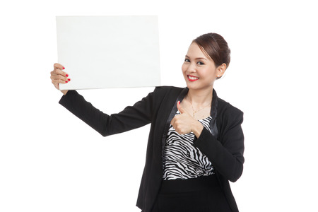well dressed girl: Young Asian business woman show thumbs up with  white blank sign  isolated on white background