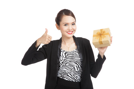 femme pouce leve: Asian business woman thumbs up with a golden gift box  isolated on white background