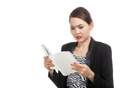 confused: Young Asian business woman confused with a book  isolated on white background