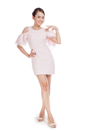 goodlooking: Happy beautiful Asian girl  in pink dress on white background