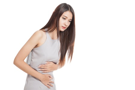 bellyache: Young Asian woman got stomachache  isolated on white background