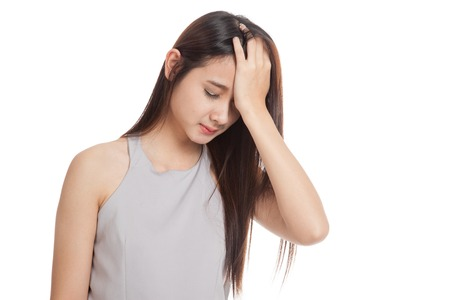 Young Asian woman got sick and headache  isolated on white background Reklamní fotografie