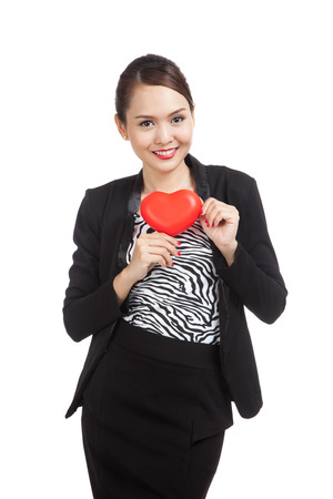 well dressed girl: Asian business woman with red heart  isolated on white background