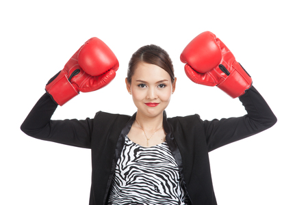 well dressed girl: Young Asian business woman with red boxing gloves  isolated on white background Stock Photo