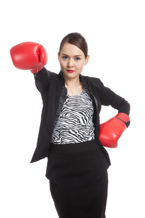 Young Asian business woman with red boxing gloves  isolated on white background 스톡 콘텐츠