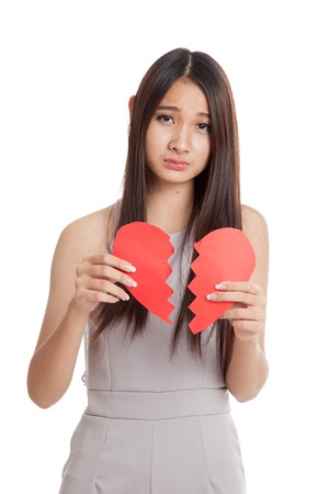 heart white: Beautiful young Asian woman with broken heart  isolated on white background