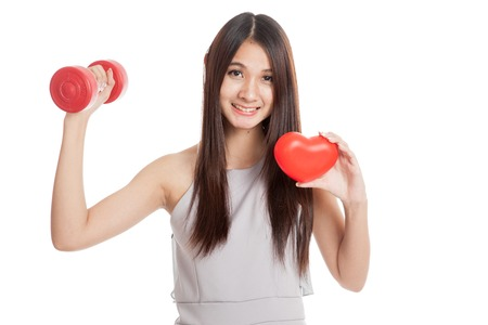 healthy smile: Beautiful young Asian woman with red heart and dumbbell  isolated on white background