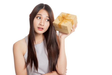 wonder woman: Beautiful young Asian woman wonder what in golden gift box isolated on white background Stock Photo