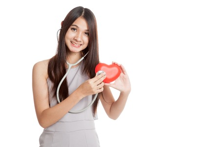 Beautiful young Asian woman with red heart and stethoscope  isolated on white background 스톡 콘텐츠