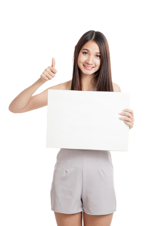 woman thumbs up: Beautiful young Asian woman thumbs up with blank sign  isolated on white background