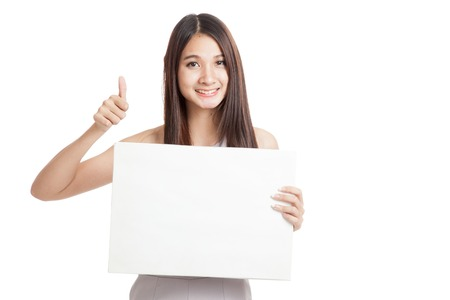 woman thumbs up: Beautiful young Asian woman thumbs up with blank sign   isolated on white background Stock Photo