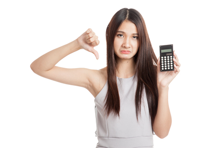Unhappy Young Asian woman thumbs down with calculator  isolated on white background