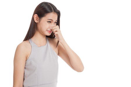 unpleasant: Young Asian woman  holding her nose because of a bad smell  isolated on white background