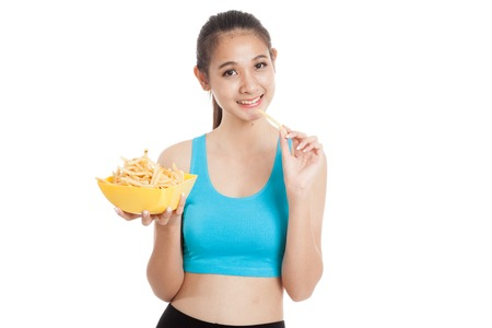 potato fries: Beautiful Asian healthy girl eat  french fries  isolated on white background Stock Photo