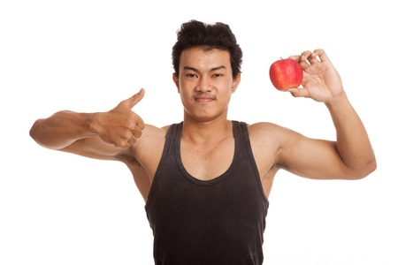 man thumbs up: Muscular Asian man thumbs up with red apple  isolated on white background