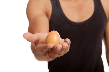 Egg in muscular Asian man's arm  isolated on white background