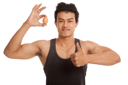 man thumbs up: Muscular Asian man thumbs up with egg  isolated on white background
