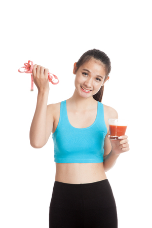 Healthy Asian girl diet with tomato juice and measuring tape on diet  isolated on white background Stock Photo