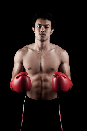 asian abs: Muscular Asian man  with red boxing glove on dark background