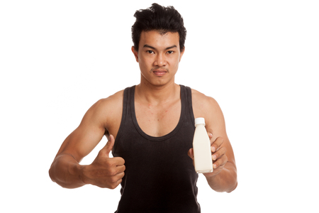 man thumbs up: Muscular Asian man thumbs up with  soy milk  isolated on white background