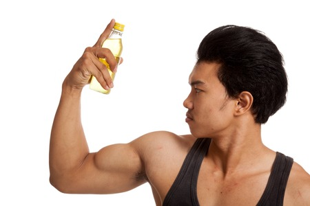 electrolyte: Muscular Asian man flexing biceps with electrolyte drink  isolated on white background