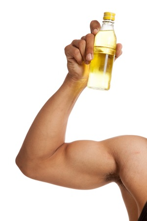 electrolyte: Muscular Asian mans arm  flexing biceps with electrolyte drink  isolated on white background Stock Photo