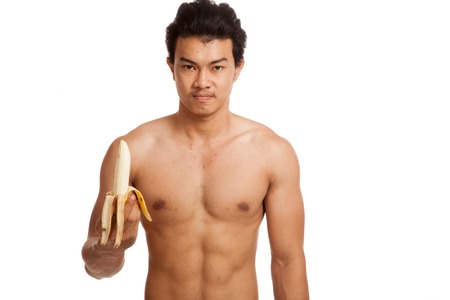 asian abs: Muscular Asian man with banana  isolated on white background Stock Photo
