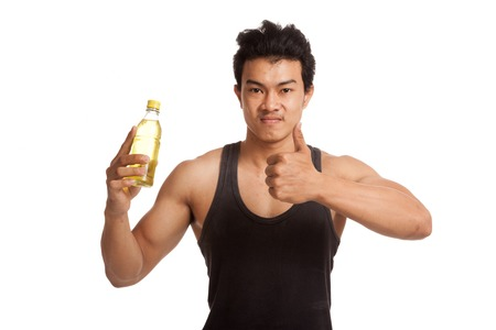 electrolyte: Muscular Asian man  thumbs up  with electrolyte drink  isolated on white background