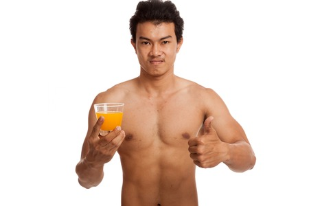 man thumbs up: Muscular Asian man thumbs up with orange juice  isolated on white background