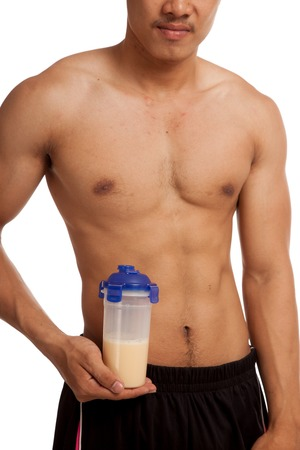 Muscular Asian man show his six pack abs whey protein  isolated on white background