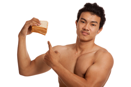 carbs: Muscular Asian man load carbs point to bread  isolated on white background Stock Photo