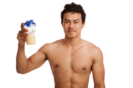 asian abs: Muscular Asian man with whey protein  isolated on white background