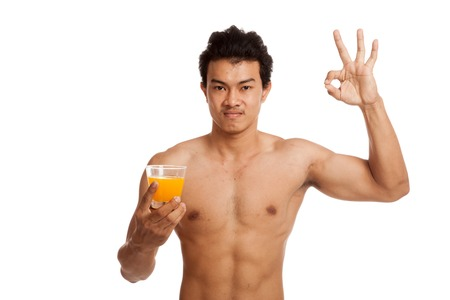 asian abs: Muscular Asian man show OK  with orange juice  isolated on white background Stock Photo