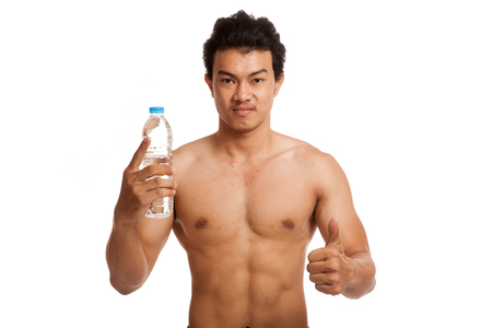 asian abs: Muscular Asian man thumbs up with bottle of drinking water  isolated on white background
