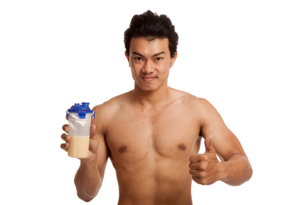 whey: Muscular Asian man thumbs up with whey protein  isolated on white background Stock Photo