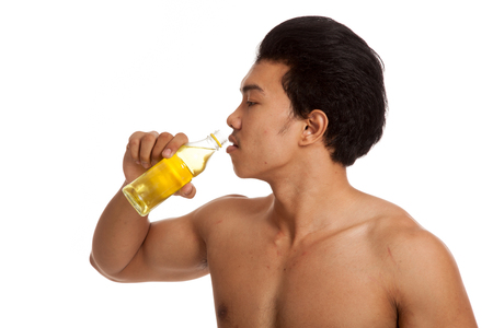 electrolyte: Muscular Asian man with electrolyte drink  isolated on white background