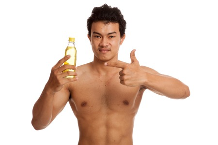 electrolyte: Muscular Asian man point to electrolyte drink  isolated on white background