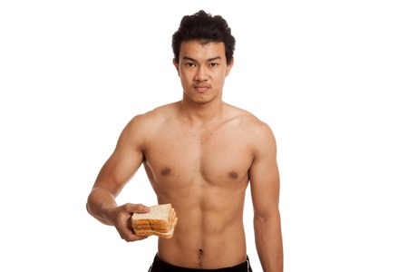 carbs: Muscular Asian man load carbs with some bread  isolated on white background Stock Photo