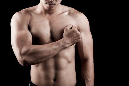 asian abs: Muscular Asian man show his body on dark background Stock Photo