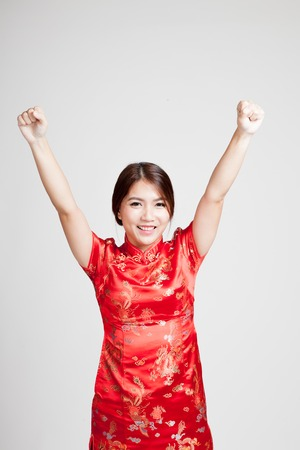 chipao: Happy Asian girl in chinese cheongsam dress on gray background