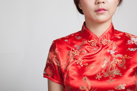 chipao: Close up of Asian girl in chinese cheongsam dress on gray background