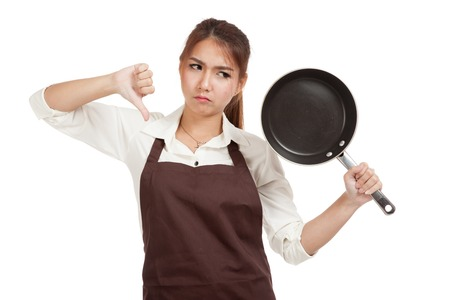 pan asian: Asian girl cooking thumbs down  with frying pan  isolated on white background