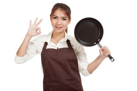 pan asian: Asian girl cook show OK  with frying pan iisolated on white background