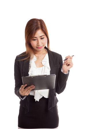 jot: Young Asian business woman with pen and clipboard  isolated on white background
